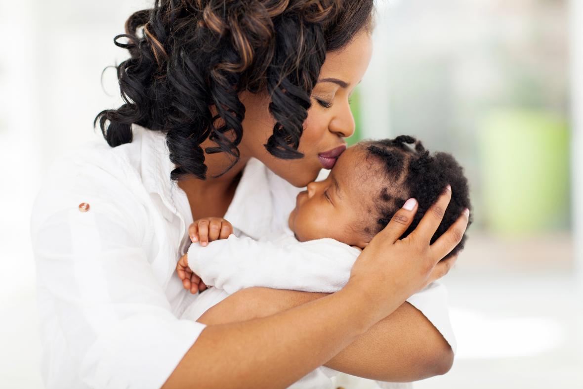 Mum kissing baby